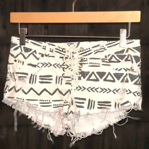 Billabong aztec print distressed shorts